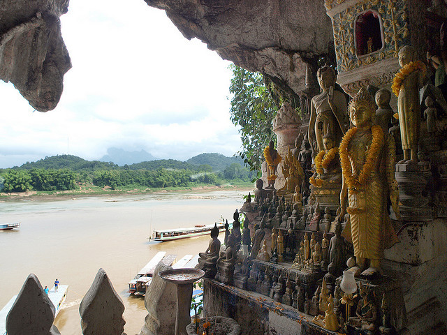 by ott1004 on Flickr.Pak Ou Caves are caves overlooking the Mekong River 25 km from Luang Prabang, Laos. They are a group of caves on the left side of the Mekong river, about two hours upstream from...