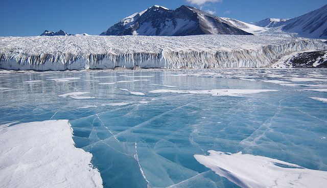 by Emily on Ice on Flickr.Blue glacial meltwater covers Lake Fryxell in the Transantarctic Mountains.