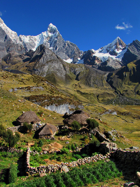 A hamlet of houses in front of Jirishanca, Huayhuash Trek, Peru