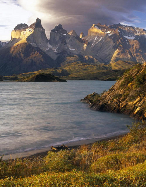 Lenticular clouds at sunset over the Cuernos del Paine from the shore of Lago Pehoe, Chile
