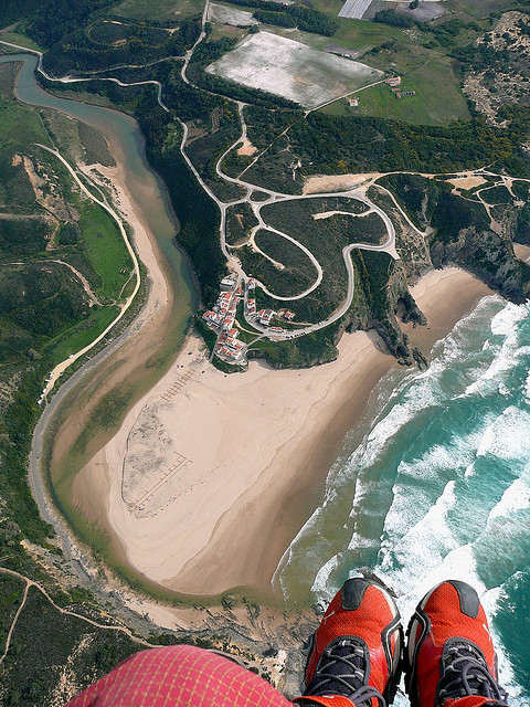 Paraglider view above Praia de Odeceixe, Algarve Coast, Portugal