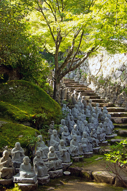 Small Buddha Statues line the stairs at Daisho-in temple, Miyajima, Japan