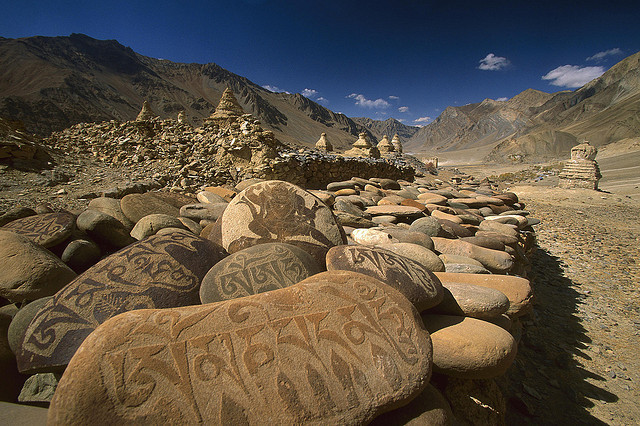 Carved buddhist mani stones below ruined palace, Zangla, India