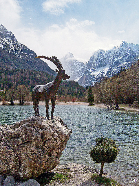The bronze ibex at Jasna Lake, Dinaric Alps, Slovenia