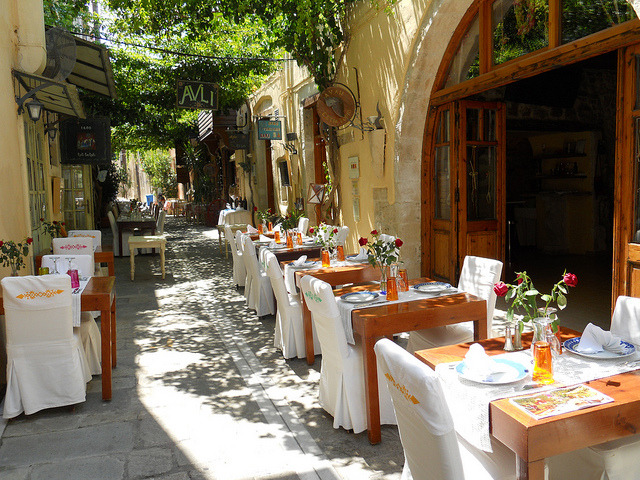 Outdoor seating in the narrow streets of Rethymno, Greece