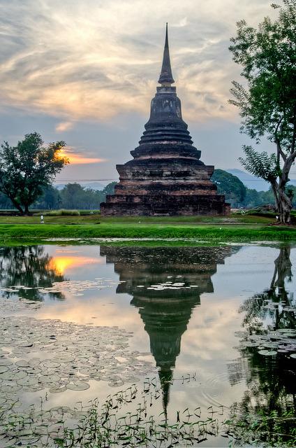 Chedi reflections in Sukhotai Historical Park / Thailand